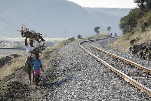 Walking along the main railway line near Ressano Garcia   by World Bank Photo Collection