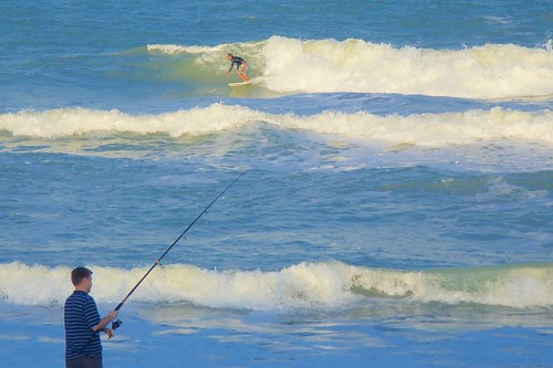 ocean beach fishing surf florida surfer surfboard fishingpole indialantic