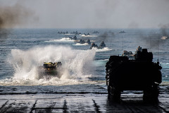 Amphibious assault vehicles from the 31st Marine Expeditionary Unit depart the well deck of USS Ashland (LSD 48), March 30 off the east coast of the Republic of Korea. (U.S. Navy/MC3 Christian Senyk)
