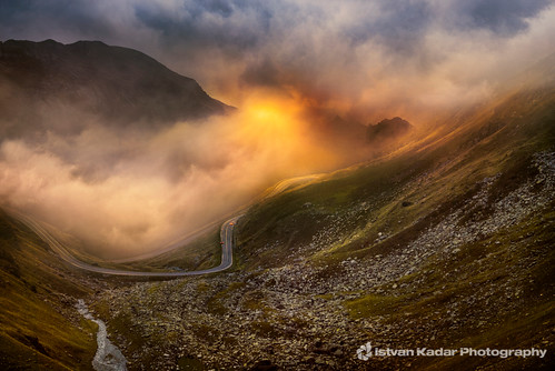 road travel sunset summer mist mountains tourism rock fog landscape highway crossing snake corridor valley romania curve highup scenics mountainpass fagaras thoroughfare famousplace transfăgărăşan multiplelanehighway transfagarasanroad travellocations carpathianmountainsrange