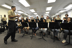 Musician 1st Class Brandon Barbee speaks to students from the Honoka'a High School Jazz Band during a music clinic at the Pacific Fleet Band Hall on Joint Base Pearl Harbor-Hickam. (U.S. Navy/MC2 Johans Chavarro)