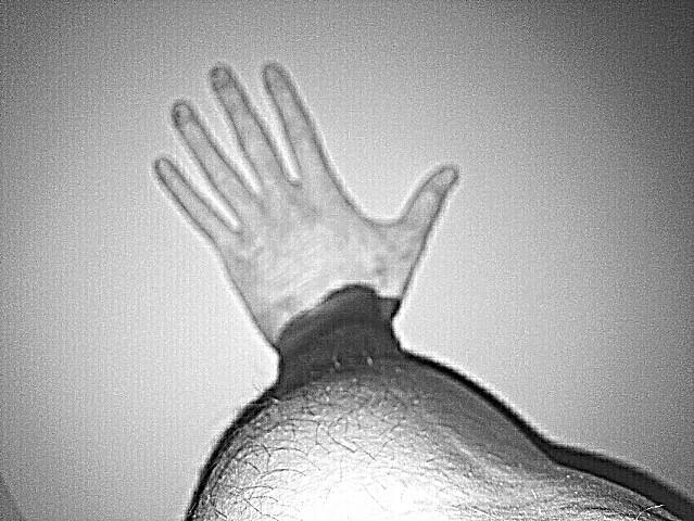 White hands. Black arm.