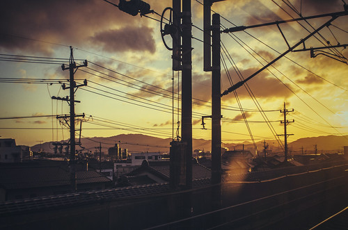 lighting travel blue light sunset cloud beautiful yellow japan clouds train japanese lights tokyo golden kyoto dusk snapshot hour infrastructure bullet traveling cloudscape pentaxk5iis