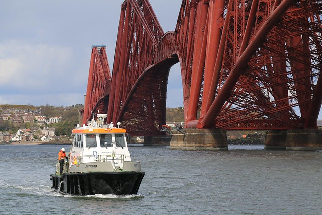 23rd April 2016. Pilot Boat, Smit Young and The Forth Rail Bridge from South Queensferry, West Lothian, Scotland