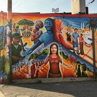 Global Refugee Project mural by Joel Bergner, with story of 3 refugees in Maryland--one fled the town he was mayor of in the Congo in war, one escaped religious persecution in Burma, and one escaped the militia in Iraq after her brother was killed. Three | by Remember To Breathe