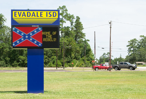 heritage hate evadale rebels high school isd independent district confederate flag insignia coat arms states america east texas csa civil war jim crow racist jasper county confederacy dylann roof kkk ku klux klan battle slavery segregation heritageofhate heritagenothate board superintendent sports champions baseball basketball racism graduation state 2000 2001 westrock company corporation paper mill employer employment tx segregated black africanamerican rights emblem crest kepi cap hat crossed sword saber de facto demographics