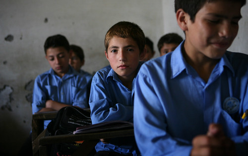 A student supported by Hashoo Foundation in a school in Chitral looks on as he attends class. | by Hashoo Foundation USA - Houston, TX