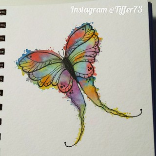 I drew this whimsy butterfly and used my Distress markers to watercolor him like stained glass!