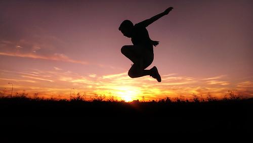 camera boy sunset arizona sun phoenix silhouette clouds kid jump phone sundown dusk htc1