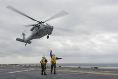 A MH-60S Seahawk helicopter assigned to Helicopter Sea         Combat Squadron (HSC) 25 takes off from the flight deck of the         forward-deployed amphibious assault ship USS Bonhomme Richard (LHD         6). (U.S. Navy/MC3 Christian Michael Caldwell)