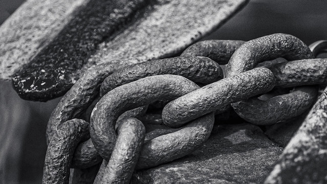 Vintage anchor chain in marina...