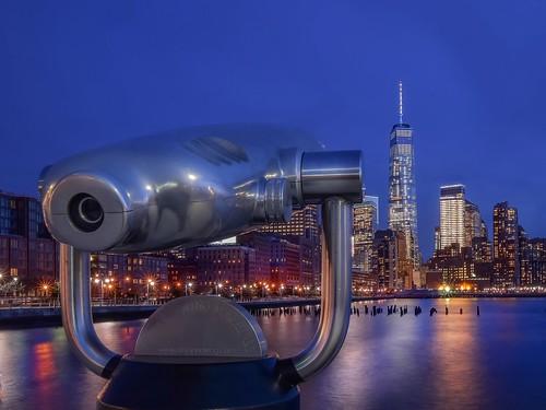 hispy travel nikond5300 machines viewing nyc architecture blue wtc sky cityscape longexposure city building newyork river viewingmachines manhattan street
