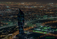 Aerial night vision of Kuwait City.