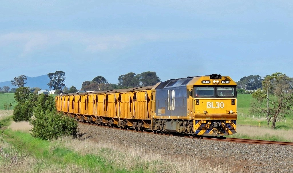 In late-afternoon sun, BL30 leads the Iluka mineral sands train southbound through Strathkellar by Adam Serena