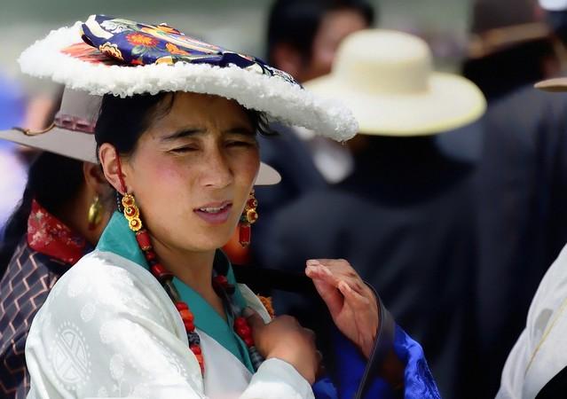 Women is wearing the Traditional Flat Hat, Tibet 2014