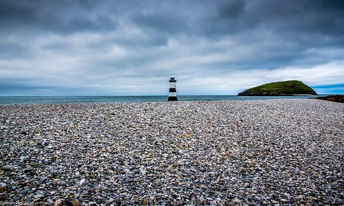 sea sky cloud lighthouse seascape colour beach water rain wales landscape island bay rocks waves stormy pebbles serene atmospheric anglesey penmon