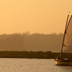 Sailing on the Zijl river, with the sun setting, almost at the horizon.