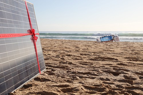 Solar panel gift on Manly beach as Common Grace ask PM Tony Abbott to #acceptthegift of solar for Kirribilli House | by kateausburn