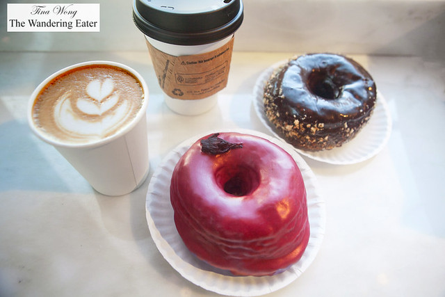 Our hibiscus and Chocolate and raspberry glazed doughnuts and cups of coffee by Dough Doughnuts