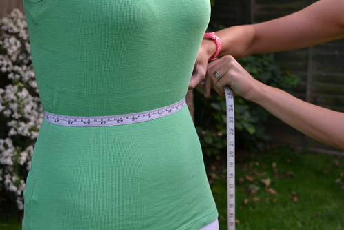 Womens Fitness Measuring Waistline | by Jonathan Rolande