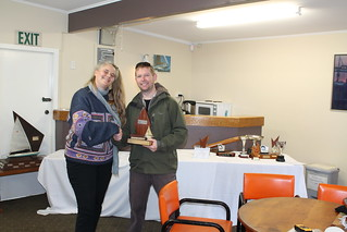 Chantal Grass presenting the Secretary Trophy - Intermediate to Chris Knight, winner of the Early Bird Series - B fleet | by PLSC (Panmure Lagoon Sailing Club)