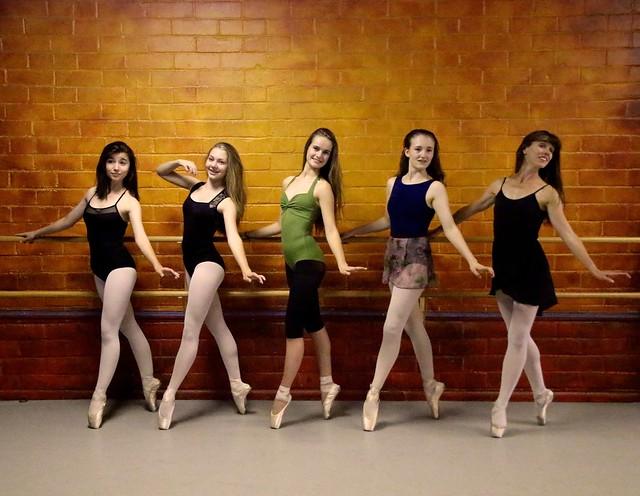 Young Ballerinas En Pointe, Posing For The Camera
