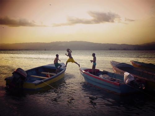 ocean sunset sea water children fun jump child play action shore