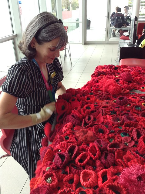 Catherine sewing the poppies - Christchurch City Libraries