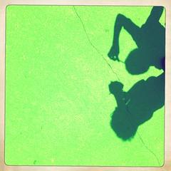 Kid shadows on neon green