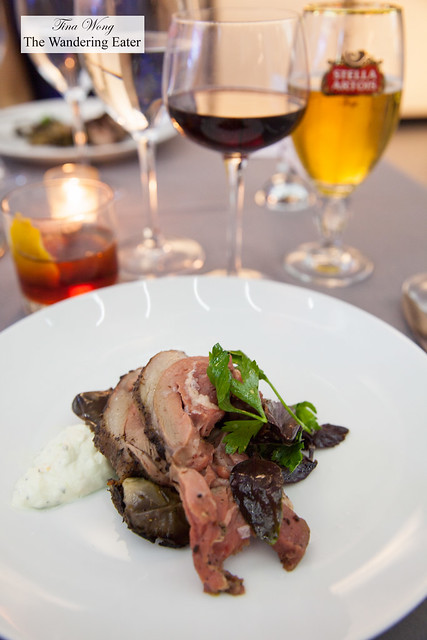 Cordero a la brasa - Slow grilled lamb shoulder, heirloom eggplant, citrus labne yogurt, chermoula paired with Tuffo Soave and Woodwork Pinot Noir