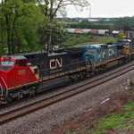CSX I676 with CN 2151 (C40-8W), IC 2463 (C40-8W), and CSX 5107 (CW44AH) Thomas Rice Special under rainy conditions