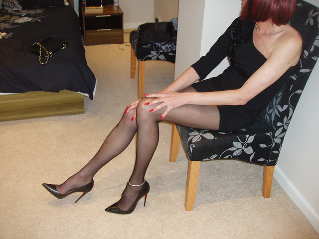 Black Off The Shoulder Dress, sheer black tights and Louboutin