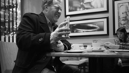 street people blackandwhite bw white man black blancoynegro coffee monochrome photography mono cafe phone noiretblanc zwartwit expression candid indoor olympus laughter unposed 黑白 biancoenero omd mft em5 obile 1442mm schwarzundweis