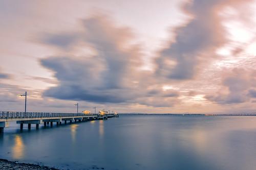 sunset sea sky water weather clouds pier redcliffe waterreflections sunsetsandsunrisesgold cloudsstormssunsetssunrises slowshutteronwater