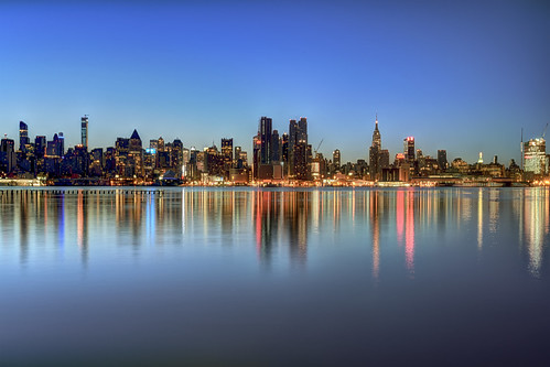 newyorkcity blue red ny newyork color colour reflection skyline skyscraper sunrise river dawn neon cityscape manhattan dramatic nopeople midtown esb license empirestatebuilding hdr gettyimages bankofamericatower onepennplaza stevekelley hudsonyards stevenkelley 432parkavenue one57tower hmtower licensenow