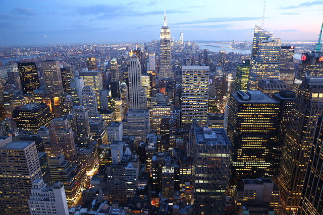 Looking at New York Empire State building skyline viewed from Rockefeller Centre 70th floor