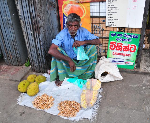 Portrait of elderly market vendor