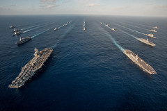 In this file photo, the Ronald Reagan Carrier Strike Group steams in formation with Japan Maritime Self-Defense Force ships during Annual Exercise in 2015. (U.S. Navy/MC3 Nathan Burke)