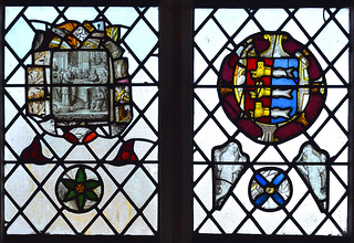 St Bridget feeds the poor (continental, 17th Century), arms of Great Yarmouth, two mermaids and a roundel