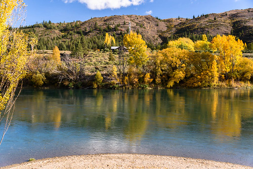 autumn trees newzealand sky house clouds reflections landscape clyde shadows scene hills autumncolours southisland centralotago autumncolour cluthariver manuherikiavalley tripdownsouth populartrees