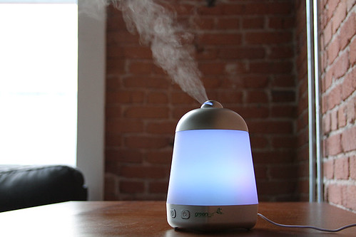 neon essential oil diffuser misting on table | by yourbestdigs