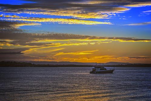 sunset sea sky water weather clouds boats sunsetsandsunrisesgold cloudsstormssunsetssunrises