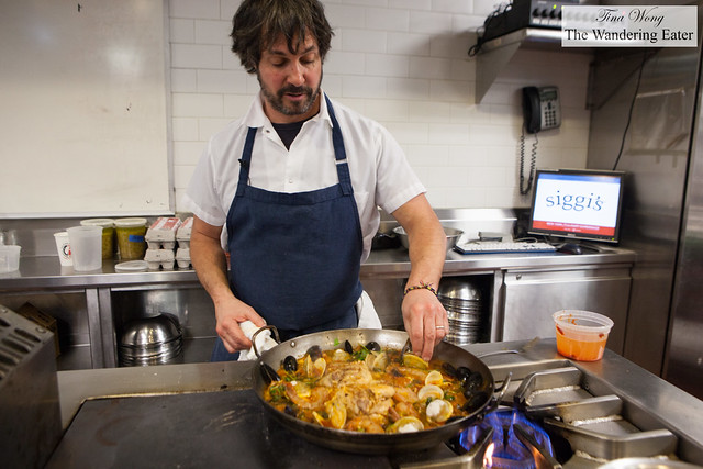 Chef Ken Oringer assembling the seafood nicely on the paella
