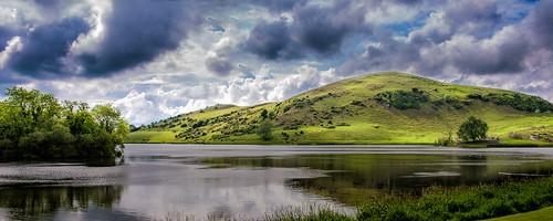 ireland mountain lake reflection green water clouds ie limerick loughgur