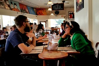 hipster couple at pizza joint | by archieflickers