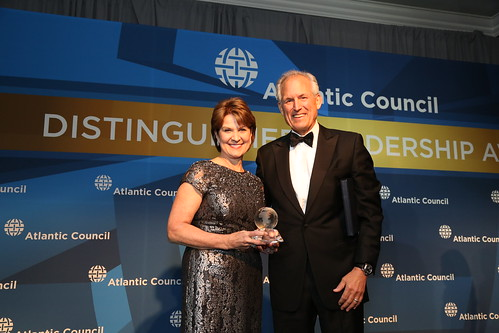 Boeing CEO James McNerny presents the 2015 Distinguished Business Leadership Award to Lockheed Martin CEO Marillyn Hewson