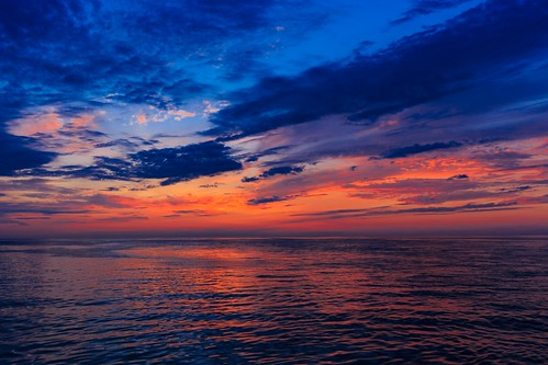 blue sunset summer sky orange water clouds michigan lakemichigan greatlakes charlevoix orangeandblue canon6d canonef35mmf2isusm