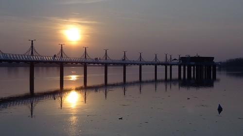 blue sunset people sun water reflections river landscape pier spring view poland polska sunny wisła płock