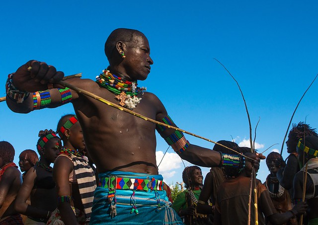 Hamer tribe maze whipping a woman during a bull jumping ceremony, Omo valley, Turmi, Ethiopia