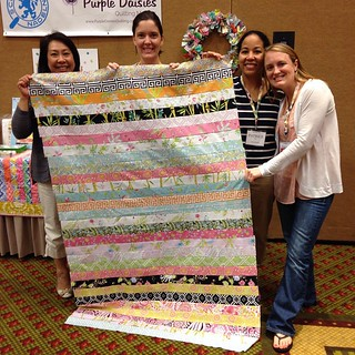 #sewsouth rocks! 15 charity quilt tops made in 10 minutes for Quilt Lemonade. Thank you @freespiritfabrics for donating the fabric